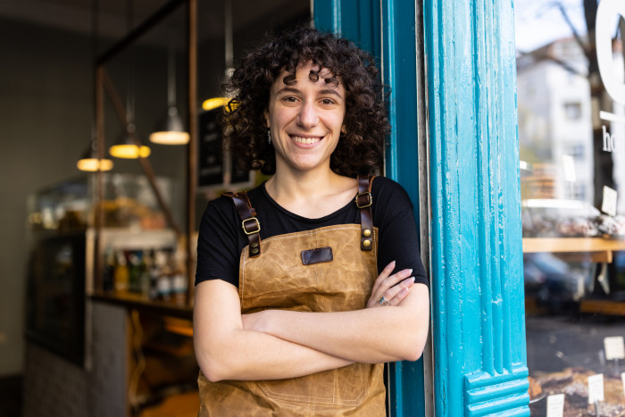 Happy non-binary small business owner portrait