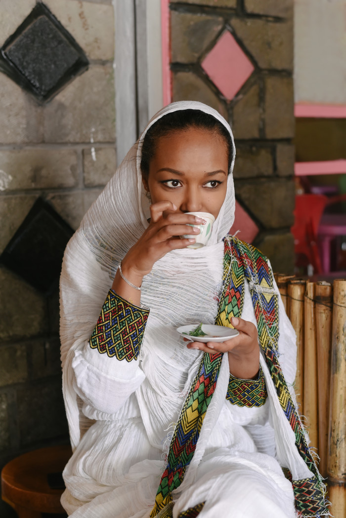 Ethiopian woman having coffee