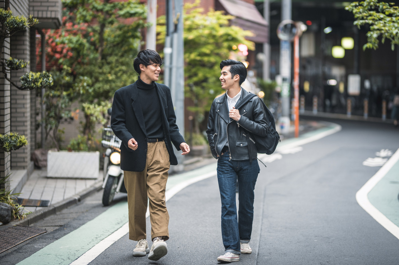 Relaxed Japanese Male Friends Walking and Talking in Tokyo