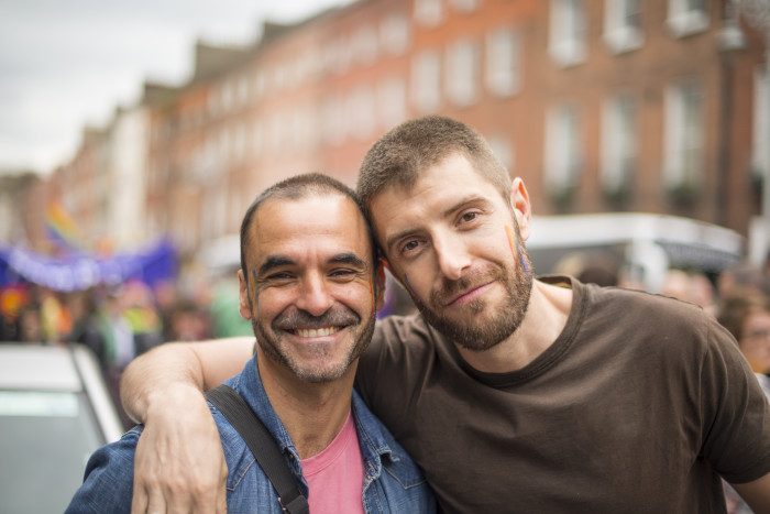 Handsome gay couple during Gay Pride Parade