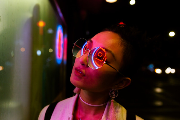 portrait of young woman under neon light