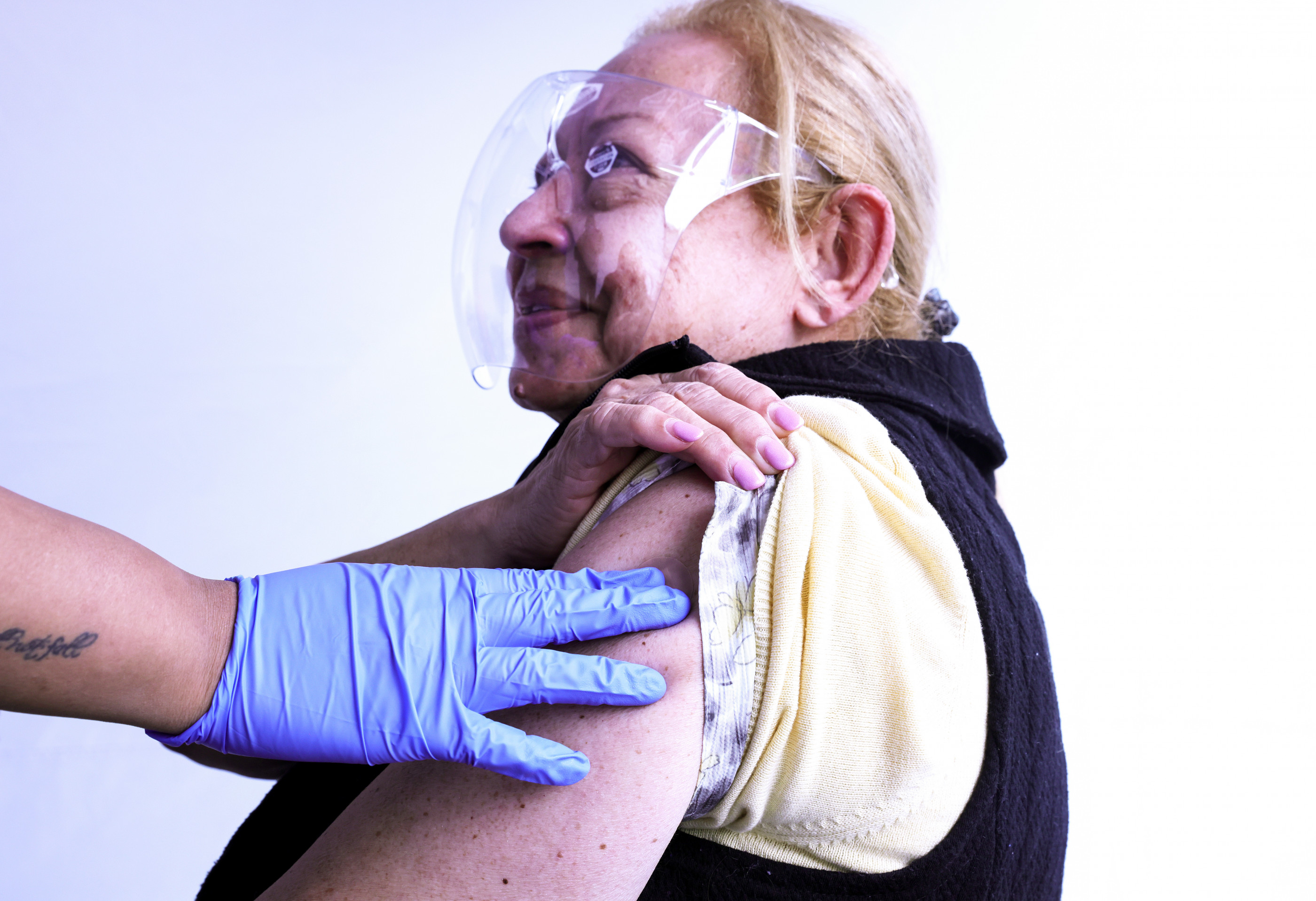 LOS ANGELES, CALIFORNIA - MARCH 25: Salwa Aziz receives an adhesive bandage after receiving a one shot dose of the Johnson & Johnson COVID-19 vaccine at a clinic targeting immigrant community members on March 25, 2021 in Los Angeles, California.  The clinic, run by the St. John's Well Child and Family Center, estimates it has vaccinated more than 100,000 people in the Los Angeles area amid reports of two undocumented women who were refused coronavirus vaccinations in Orange County Rite Aid stores. Rite Aid has called the refusals mistakes in a written statement. (Photo by Mario Tama/Getty Images)