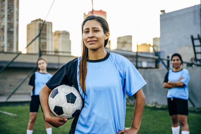 Confident young Hispanic footballer identifying as male